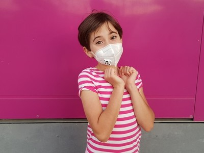 Child girl wearing a protection mask against coronavirus during Covid 19 pandemic