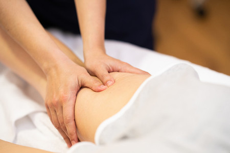 Medical massage at the leg in a physiotherapy center