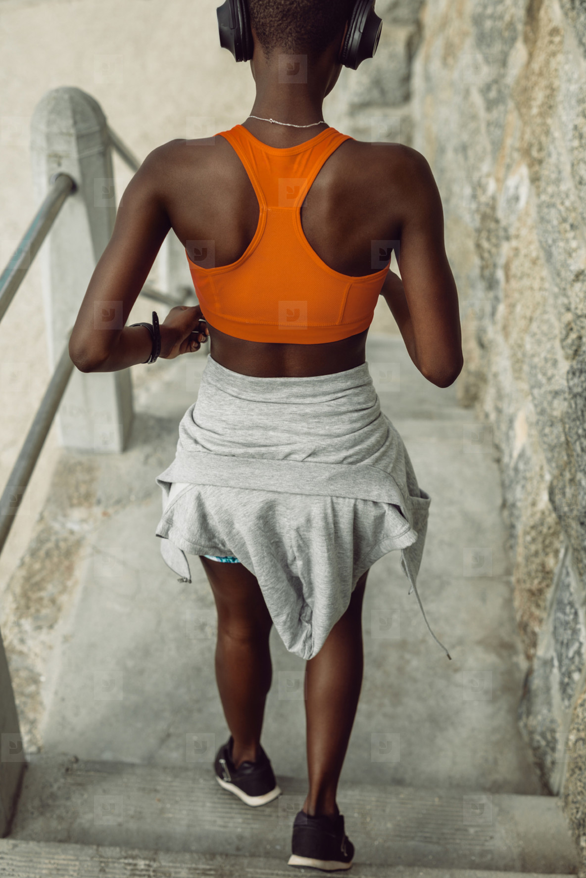 Fitness woman running down the steps