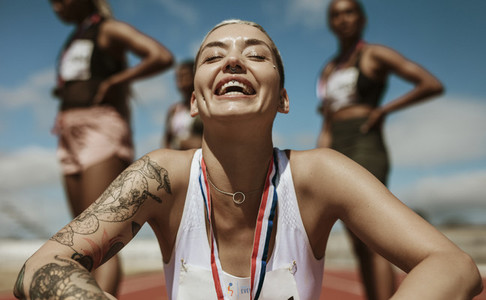 Female runner enjoying the success after winning the race