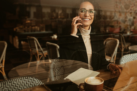 Businesswoman talking with client over a phone call