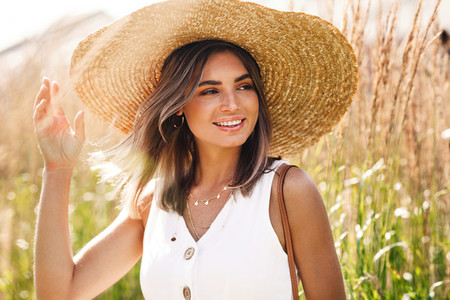Young happy woman wearing hat