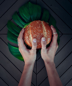 Hand hold a burger