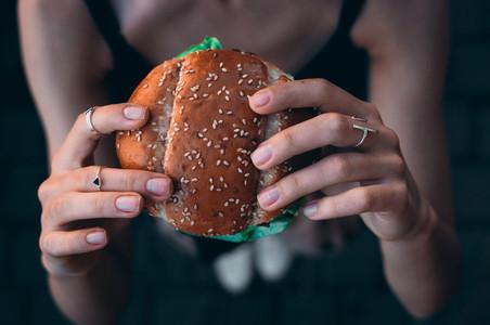 Hand hold a burger