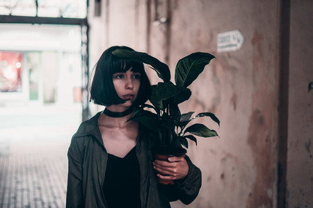 Young cute woman with houseplant