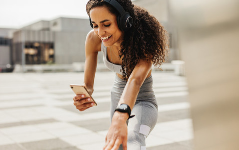 Woman using phone during workout