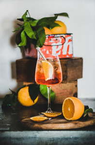 Aperol Spritz cocktail in glass with eco friendly straw on board