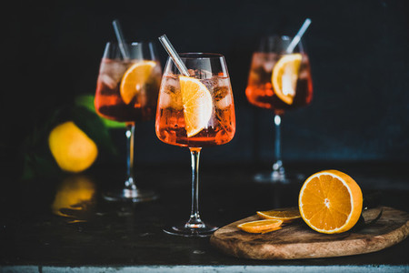 Aperol Spritz cocktail in glass with fresh oranges  black background