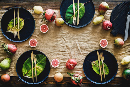 Autumn table styling with black dinnerware and leaves copy space