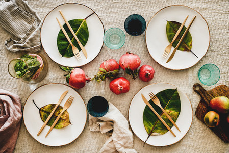 Fall table setting with fallen leaves for family gathering
