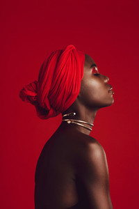 Profile view of attractive woman wearing a red turban
