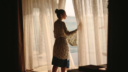 Woman at a luxury sea resort