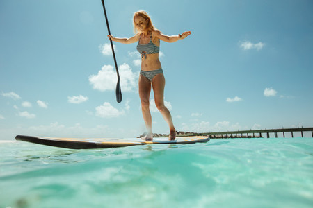 Stand up paddleboarding at a tropical beach