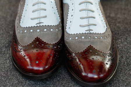 Close up of patent leather shoes brogues