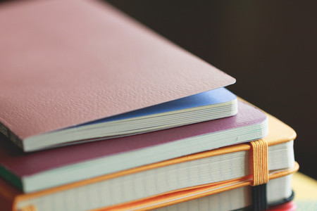 Stack of colorful notebooks