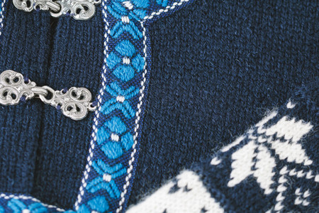 Close up of a blue and white Norwegian wool sweater
