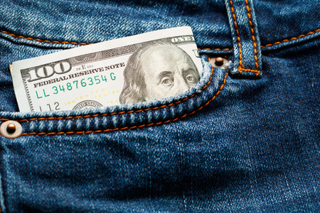 Hundred dollar bill in jeans pocket  Close up