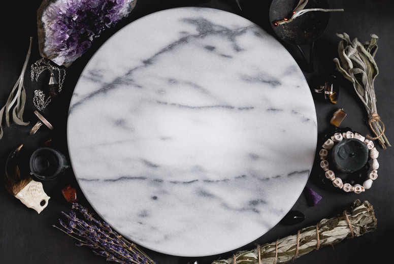 Top view at place for practice witchcraft  White marble tray surrounded magic ritual things