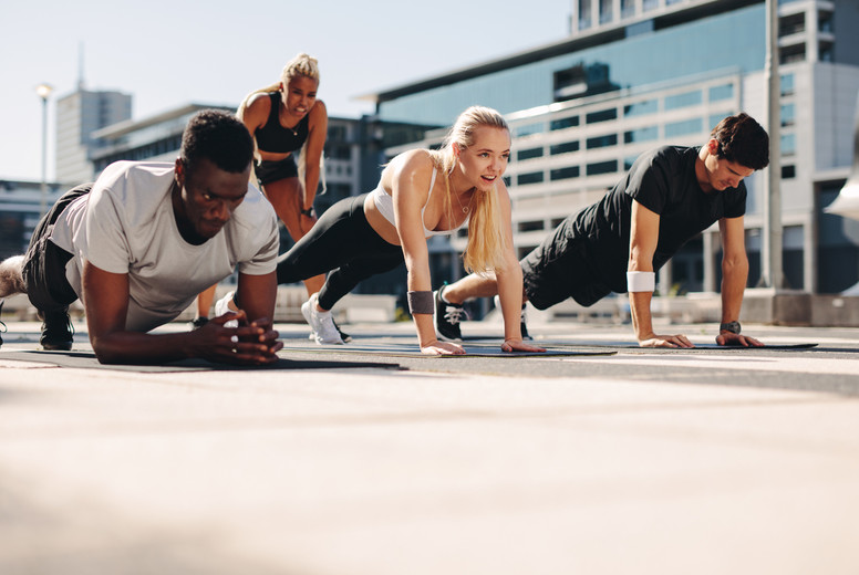 Fitness group working out together in the city