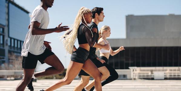 Street runners running in the city