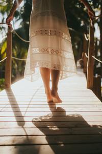 Woman walking on a wooden bridge