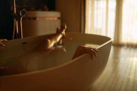Woman bathing in a bathtub