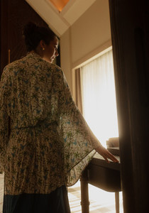 Woman in night gown at a luxury hotel