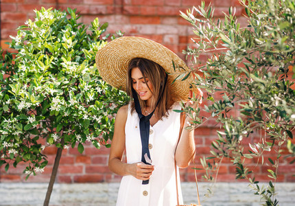 Stylish woman with straw hat