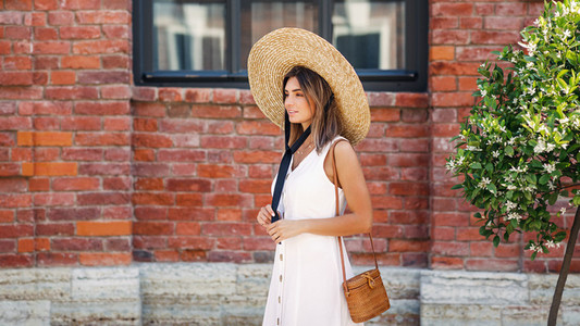 Stylish woman wearing straw hat