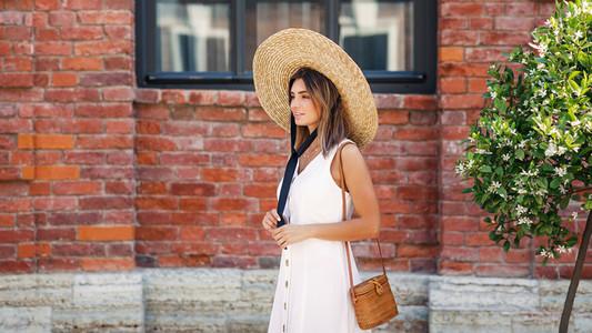 Stylish woman wearing straw hat