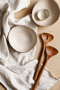 Modern minimalist ceramics set over a linen cloth  Natural products or food concept  top view  flat lay