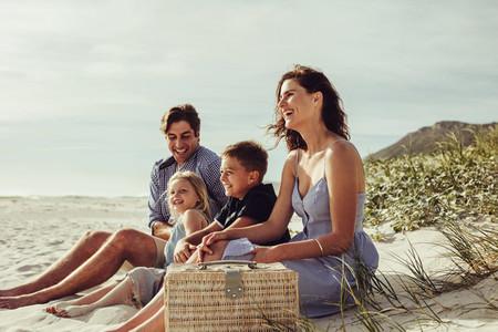 Happy family enjoying vacation at the beach