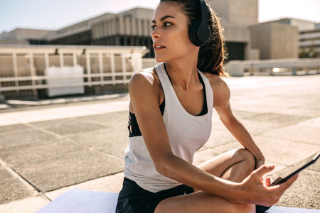 Woman listening to music while exercising