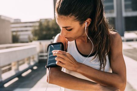Choosing her favorite workout music