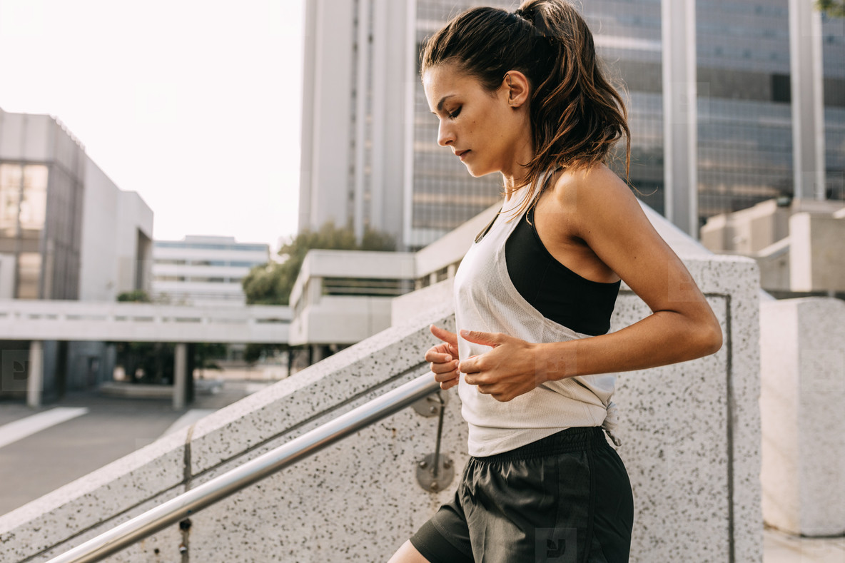 Sporty woman exercising in the city