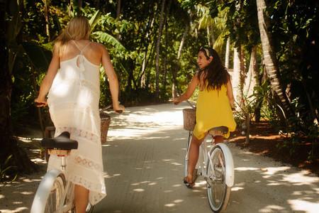Women having fun riding bicycles