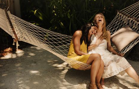 Happy friends enjoying a beach holiday