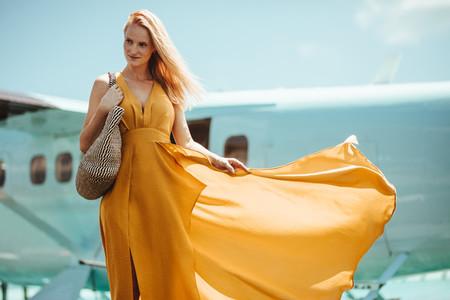 Tourist woman in bright summer fashion wear