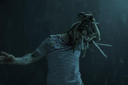 Man with dreadlocks dancing