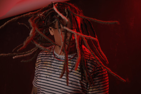 Man with long dreadlocks flipping hair