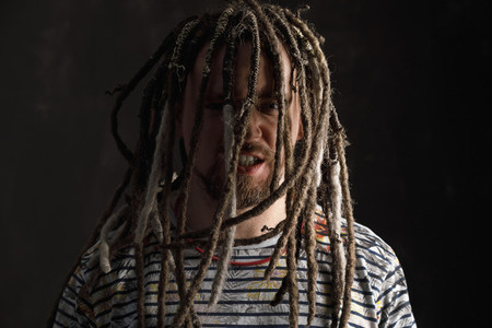 Portrait aggressive man with long dreadlocks