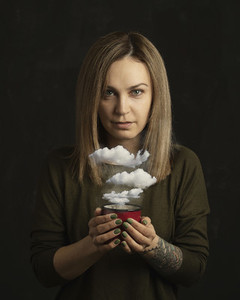 Portrait woman holding coffee cup with clouds