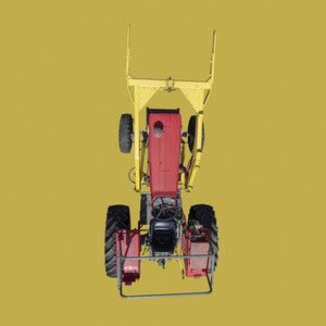 View from above red tractor on yellow background