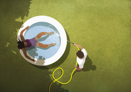 Man filling wading pool with water for wife