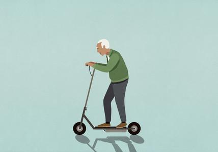 Senior man riding motorized scooter