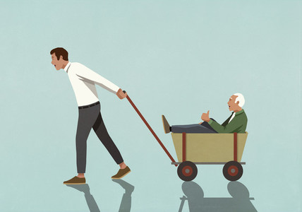 Man pulling senior father in wagon