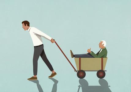 Man pulling senior father in wagon