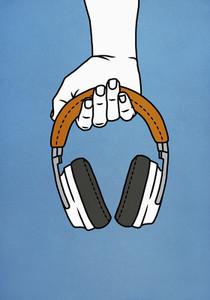 Hand holding headphones