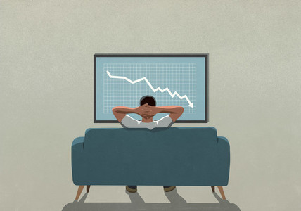 Man on sofa watching stock market decline on TV