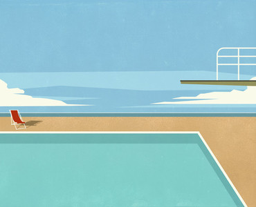 Diving board over swimming pool with ocean view